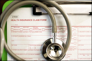 Insurance claim form with stethescope on top of it
